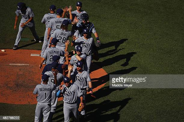 The Tampa Bay Rays celebrate their 43 win over the Boston Red Sox at Fenway Park on August 2 2015 in Boston Massachusetts