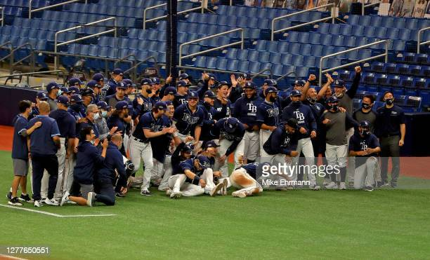 The Tampa Bay Rays celebrate winning the American League Wild Card Series in two games against the Toronto Blue Jays at Tropicana Field on September...
