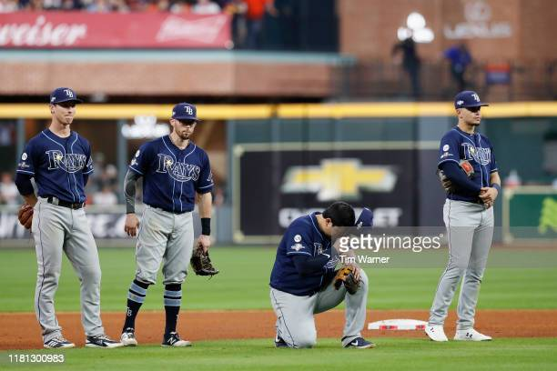The Tampa Bay Rays infield reacts during a pitching change in the seventh inning against the Houston Astros during game five of the American League...