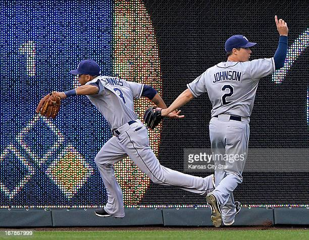 The Tampa Bay Rays' Kelly Johnson signals a catch by center fielder Desmond Jennings for an out on the Kansas City Royals' Alex Gordon in the first...