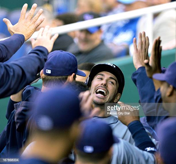 The Tampa Bay Rays' Matt Joyce is congratulated in the dugout after hitting a solo home run in the first inning against the Kansas City Royals on...