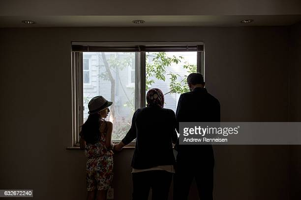The Tanbal family arrives at their new home for the first time on July 24 2015 in Bloomfield Hills Michigan Since the war started the United States...