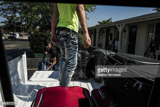 The Tanbal family leaves their hotel in Madison Heights Michigan on July 24 to go to their new home in Bloomfield Hills The Kurdish family fled their...
