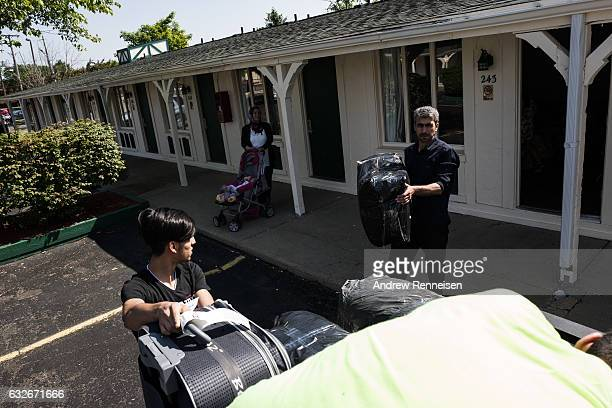 The Tanbal family packs to move to their new home in Bloomfield Hills on July 24 2015 after a brief stay in a hotel in Madison Heights Michigan Since...