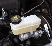 The tank with brake fluid in the car in the engine compartment. The concept of the working brake system, safety