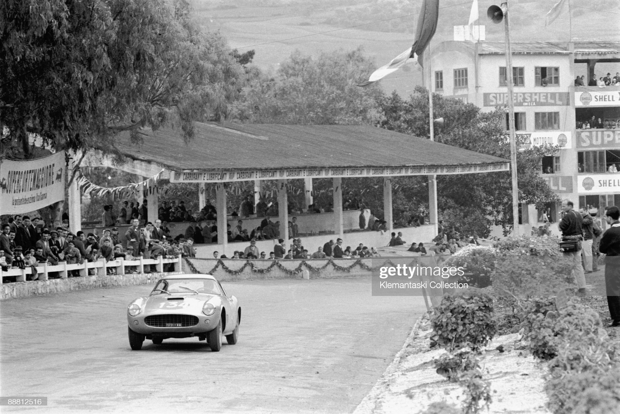 the-targa-florio-sicily-may-8-1960-past-the-pits-comes-the-year-old-picture-id88812516