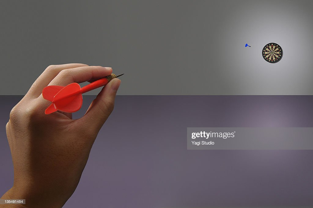 The target of the darts and hand : Stock Photo