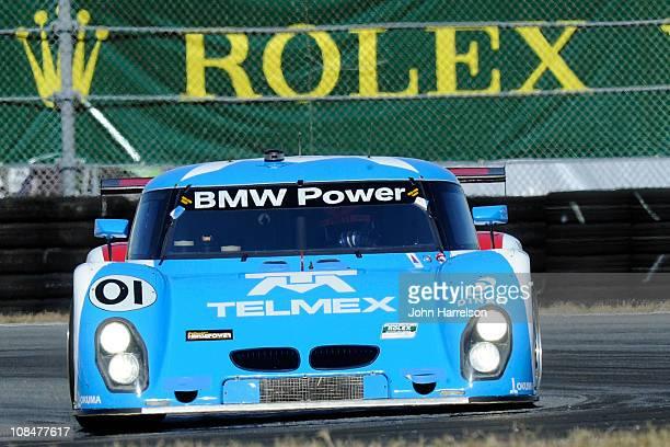 The Target/TELMEX BMW Riley driven by Scott Pruett Memo Rojas Graham Rahal Joey Hand drives duing practice for the Rolex 24 at Daytona International...