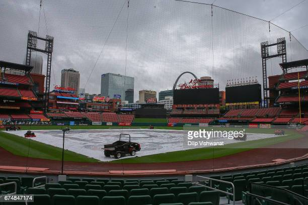 The tarp covers Busch Stadium's field after the game between the St Louis Cardinals and the Cincinnati Reds was cancelled due to rain on April 29...
