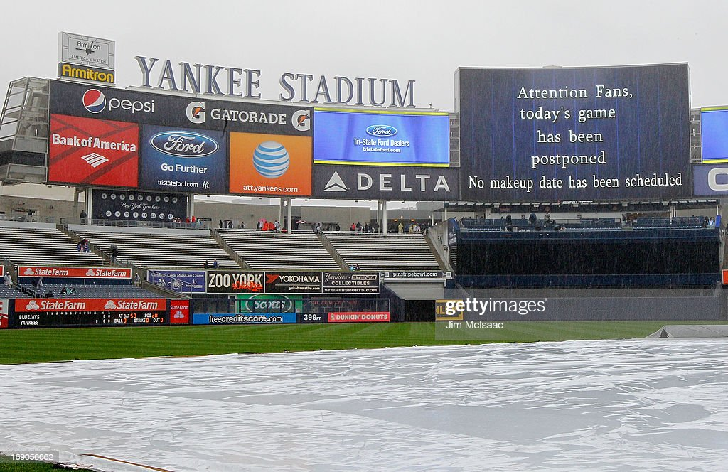 The tarp covers the field as a game between the New York Yankees and the Toronto Blue Jays has been postponed due to rain at Yankee Stadium on May 19, 2013 in the Bronx borough of New York City.