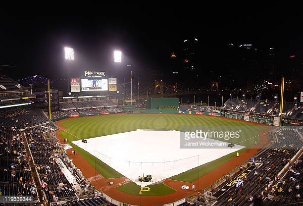 The tarp covers the infield at PNC Park during the second rain delay between the Pittsburgh Pirates and the Cincinnati Reds on July 18 2011 in...