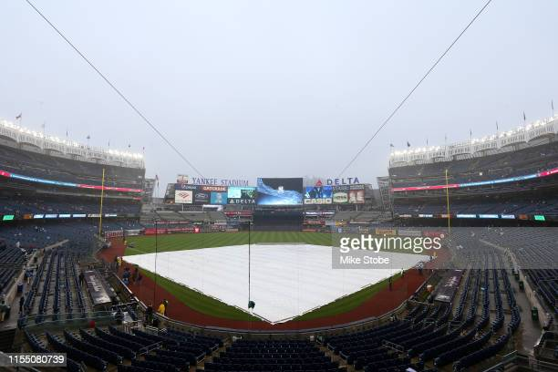 The tarp is seen on the field prior to the game between the New York Yankees and the New York Mets at Yankee Stadium on June 10, 2019 in the Bronx...