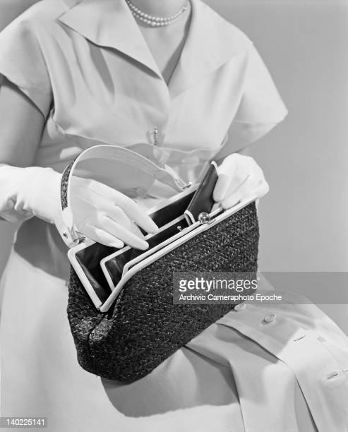 The 'Tascapane' handbag in purple raffia by Giuliana Camerino in Venice Italy circa 1955