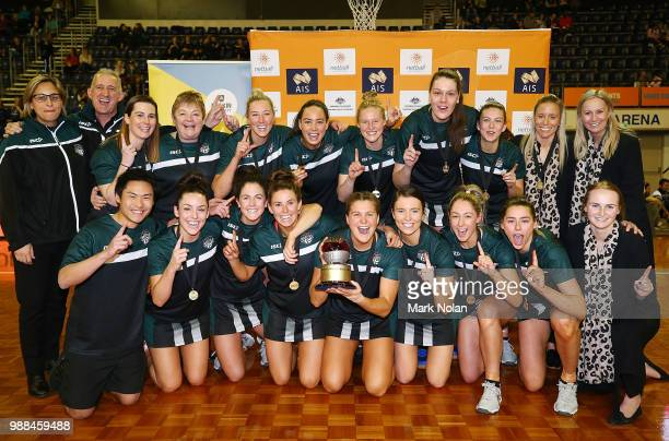 The Tasmanian Magpies pose for a team photo after wining the Australian Netball League grand final between the Tasmanian Magpies and the Canberra...