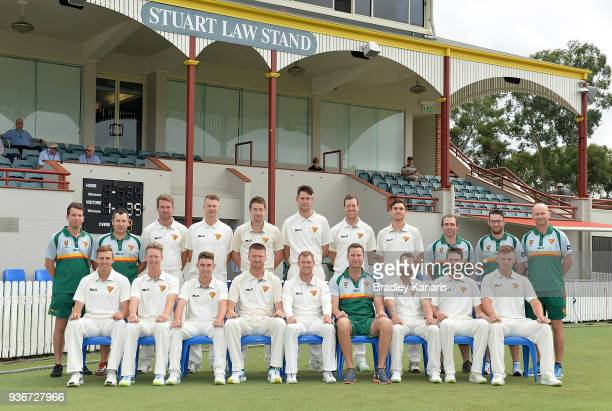 The Tasmanian team pose for a photo before the start of play on day one of the Sheffield Shield final match between Queensland and Tasmania at Allan...