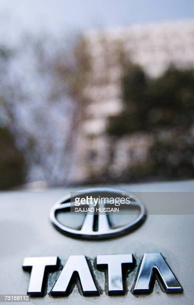 The Tata logo shines on the boot of a car reflecting highrise buildings of south Mumbai's business district 31 January 2007 India's Tata Steel said...
