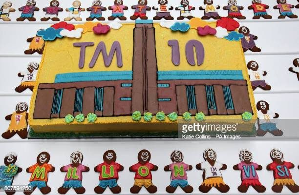 The Tate Modern 10th birthday cake surrounded by gingerbread men at the Tate Modern 10th birthday cake cutting event at the Tate Gallery London
