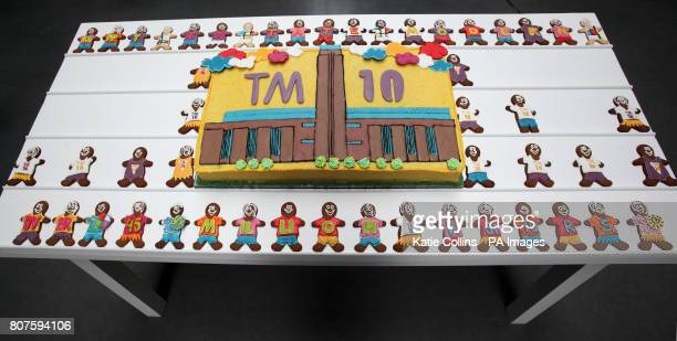 The Tate Modern 10th birthday cake surrounded by gingerbread men during the Tate Modern 10th birthday cake cutting event at the Tate Gallery London