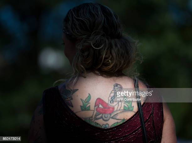 The tatoo of a woman attending Dardanella a Great Gatsby Lawn party is highlighted near the National Cathedral in Washington DC on September 23 2017...