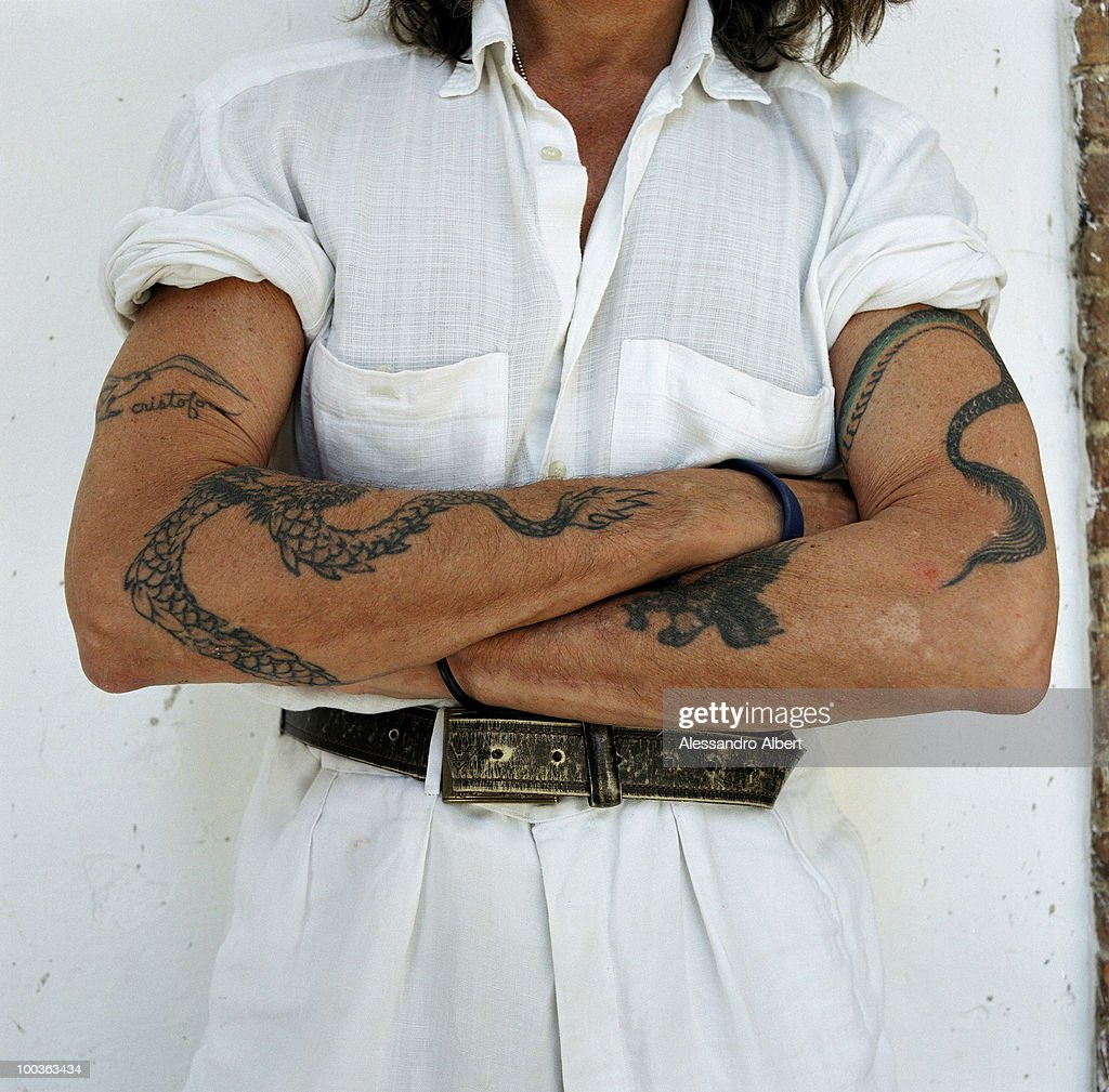 The tattoo of the wine consultant Gelasio Gaetani d'Aragona Lovatelli poses for a portraits session in the Villa Argiano on July 12, 2006 in Argiano, Italy