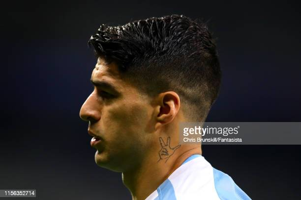 The tattoo on the neck of Luis Suarez of Uruguay is seen during the Copa America Brazil 2019 group C match between Uruguay and Ecuador at Mineirao...