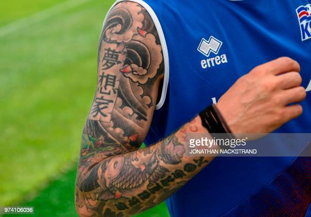 The tattooed arm of Iceland's defender Ari Skulason is picturecd before a football training session at Olimp Stadium in Kabardinka on June 14 ahead...