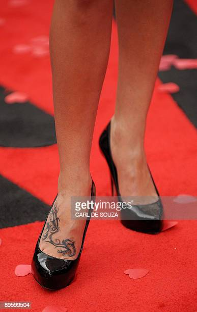 The tattooed foot of Karly Ashworth a Scottish contestant in the reality tv show Big Brother is pictured at the European premiere of the film The...