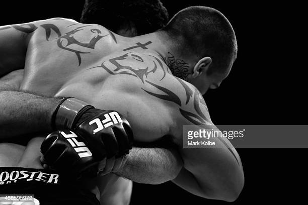 The tattoos of Guto Inocente are is seen in the Octagon as he fights Anthony Perosh in their light heavyweight fight during the UFC Fight Night 55...