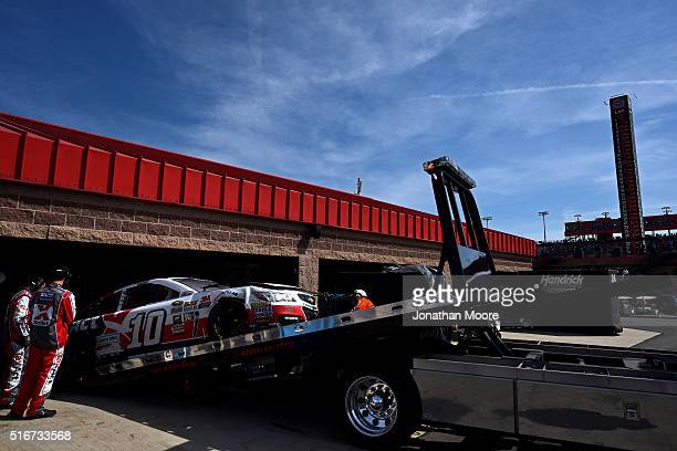 The TaxACT Chevrolet driven by Danica Patrick is towed to the garage after being involved in an ontrack incident during the NASCAR Sprint Cup Series...