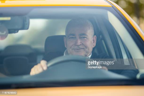 the taxi driver. - taxi driver stock pictures, royalty-free photos & images