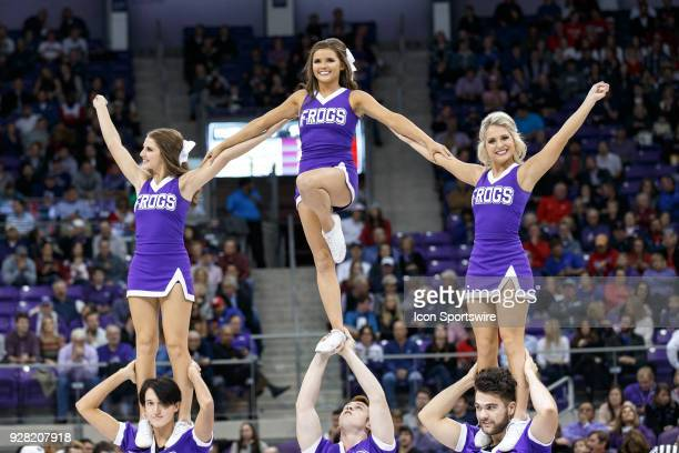The TCU cheerleaders perform during the college basketball game between the TCU Horned Frogs and the SMU Mustangs on December 5 at the Ed Rae...
