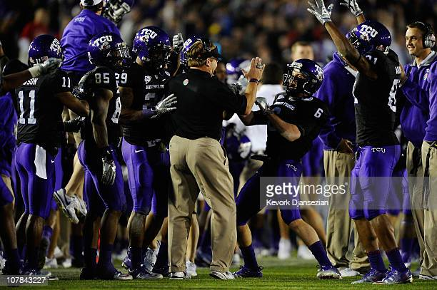 The TCU Horned Frogs celebrate after recovering an onside kick by the Wisconsin Badgers in the fourth quarter of the 97th Rose Bowl game on January...