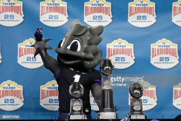 The TCU Horned Frogs mascot stands with the trophies after the Valero Alamo Bowl against the Stanford Cardinal at Alamodome on December 28 2017 in...