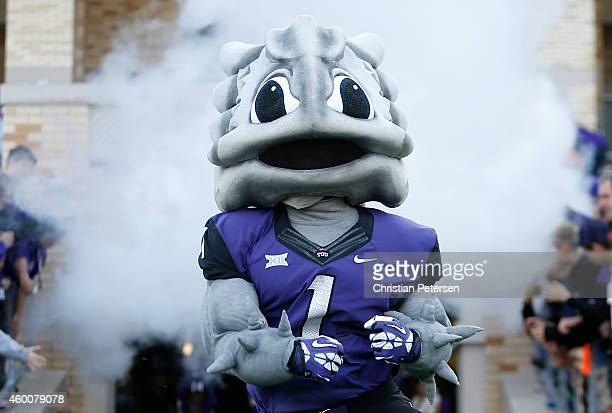 The TCU Horned Frogs mascot Super Frog performs during the Big 12 college football game against the Iowa State Cyclones at Amon G Carter Stadium on...