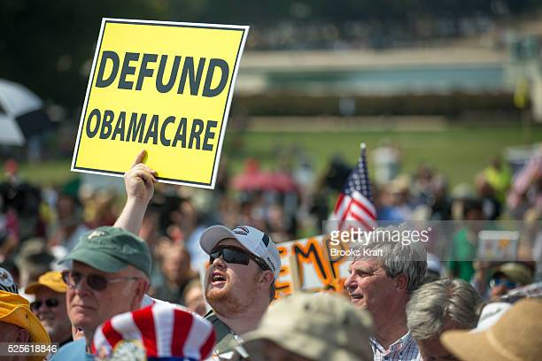 The Tea Party holds an Exempt America from Obamacare rally on Capitol Hill in Washington Sen Ted Cruz and Sen Rand Paul attended the event
