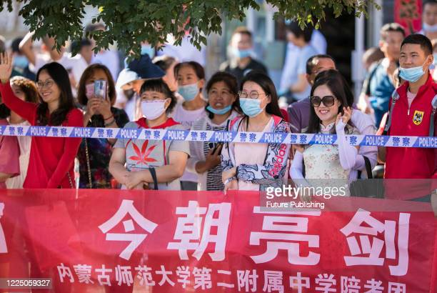 The teacher cheered the students on when they took the college entrance examination. Hohhot, Inner Mongolia, China, July 7, 2020.- PHOTOGRAPH BY...