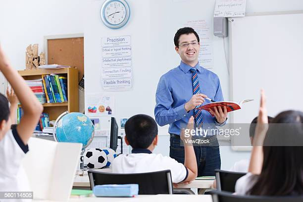 The teacher is for primary school students in class