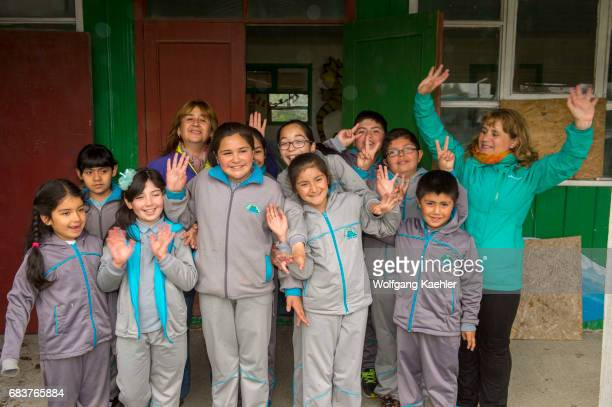 The teachers with students waving in the village of Pargua in the Lake District of Chile