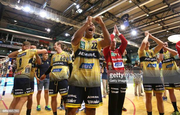 The Team and Mads Mensah Larsen of RheinNeckarLoewen celebrate their teams win after the Game SG Flensburg Handewitt v Rhein Neckar Loewen at...