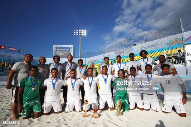 The team and staff of Iran pose with their 3rd place award after the FIFA Beach Soccer World Cup Bahamas 2017 final between Tahiti and Brazil at...