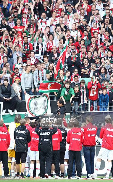 The team and the fans celebrate head coach Jos Luhukay after the Bundesliga match between FC Augsburg and Hamburger SV at SGL Arena on May 5 2012 in...