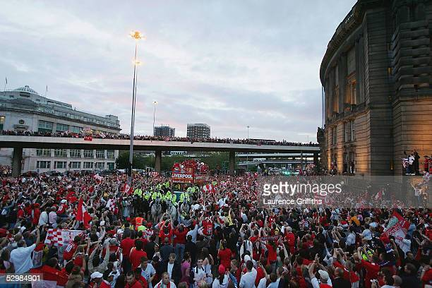 The team bus approaches St George's Square during the homecoming victory parade through the streets of Liverpool on May 26 2005 in Liverpool England...