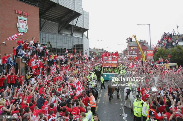 The team bus goes past the Kop at Anfield during the homecoming victory parade through the streets of Liverpool on May 26 2005 in Liverpool England...