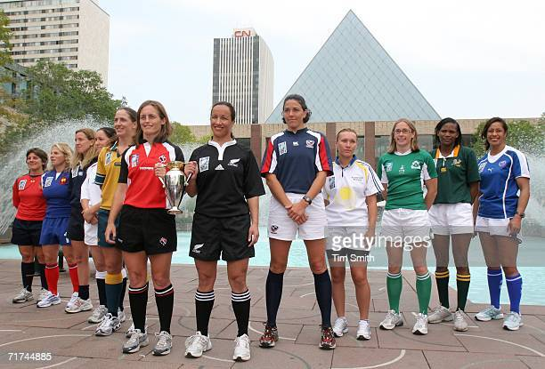 The team captains for all 12 countries participating in the Women's Rugby World Cup 2006, pose for a photo with the Rugby World Cup on August 29,...
