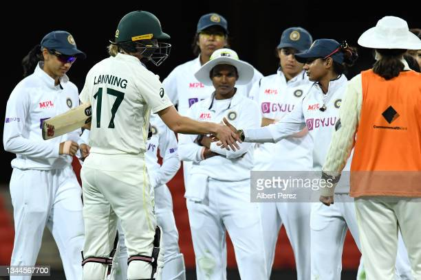 The team captains Meg Lanning of Australia and Mithali Raj of India declare a draw during day four of the Women's International Test Match between...