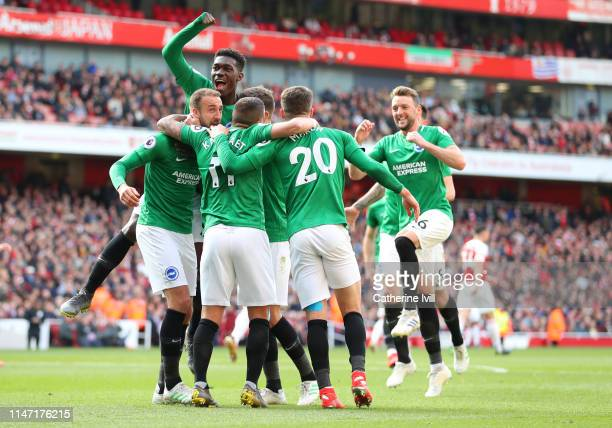 The team celebrate after Glenn Murray of Brighton Hove Albion scores his sides first goal during the Premier League match between Arsenal FC and...