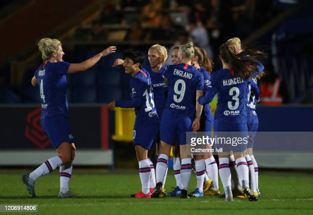 The team celebrate after Guro Reiten of Chelsea scores her teams first goal during The Women's FA Cup Fifth Round match between Chelsea Women and...