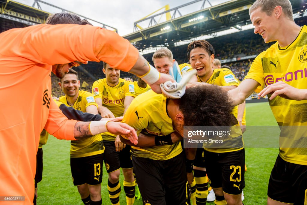 The team celebrates Pierre-Emerick Aubameyang of Borussia Dortmund for getting the trophy for being the top scorer of this season after the final whistle during the Bundesliga match between Borussia Dortmund and Werder Bremen at Signal Iduna Park on May 20, 2017 in Dortmund, Germany.