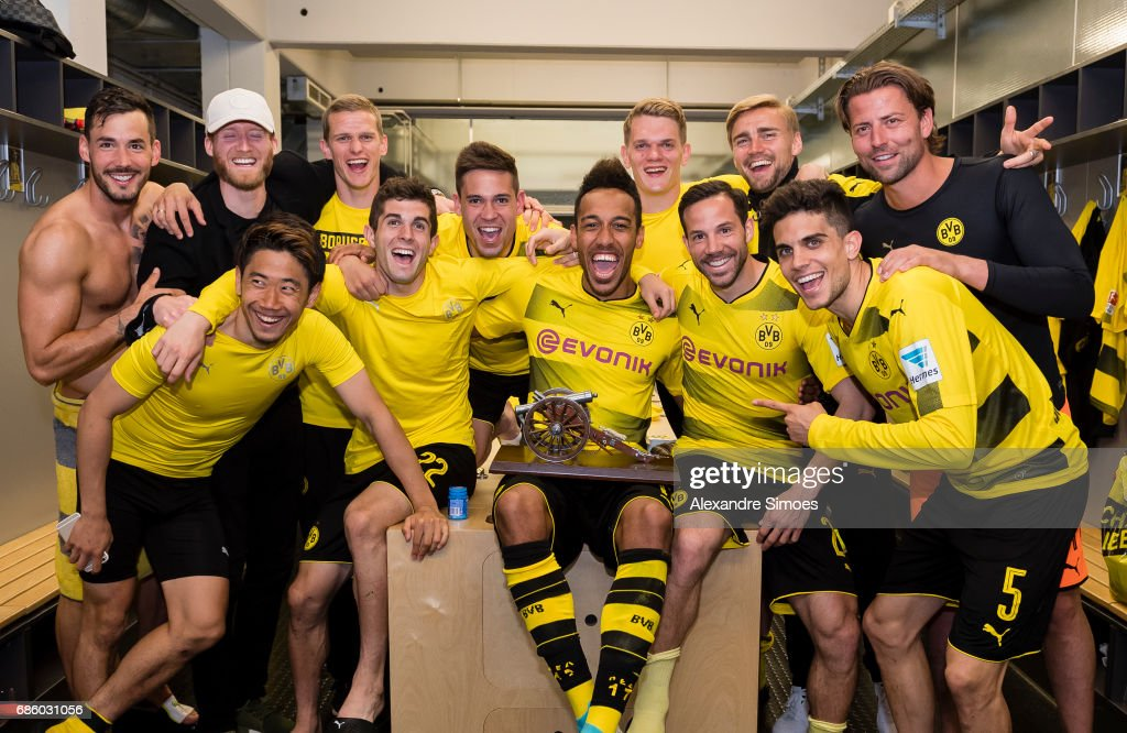 The team celebrates Pierre-Emerick Aubameyang of Borussia Dortmund for getting the trophy for being the top scorer of this season after the final whistle during the Bundesliga match between Borussia Dortmund and Werder Bremen at Signal Iduna Park on Mai 20, 2017 in Dortmund, Germany.
