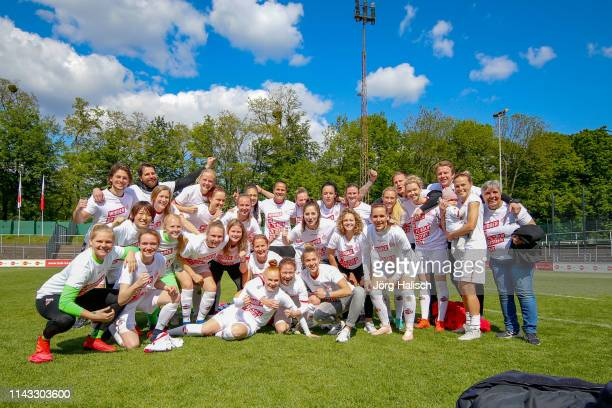 the team celebrates the climb during the women's second Bundesliga match between 1FC Koeln and 1FC Saarbruecken at FranzKremer Stadion on May 12 2019...